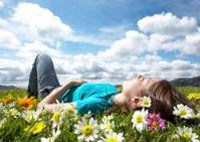 Girl lying in a flower meadow