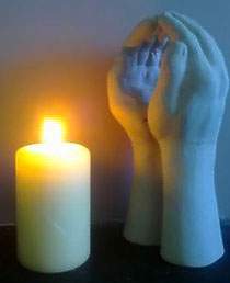 Diamond Intuitive healing hands and a candle